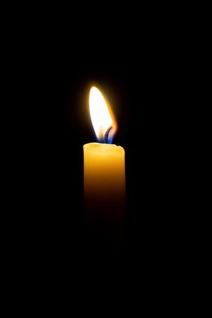 candle flame, burn isolated on black background. Stock Photo