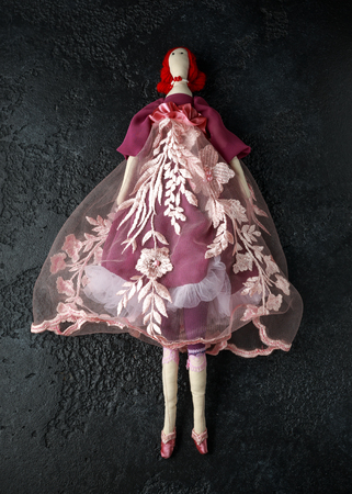 Handmade doll tilda in beautiful dress with red hair Banco de Imagens
