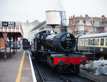 restored British steam locomotive 7827 'Lydham Manor', Paignton, Devon, England, United Kingdom, May 24, 2018. Zdjęcie Seryjne - 124998848