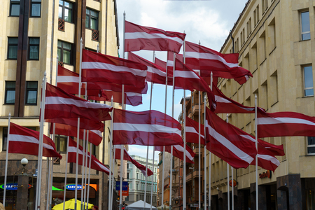 many flags of Latvia in the center of city. Riga, Latvia, July 20, 2018 写真素材 - 124998855