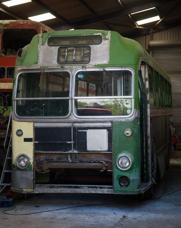 vintage old retro green bus in garage. Zdjęcie Seryjne