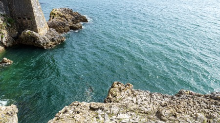 Stone rock and blue sea, ocean water