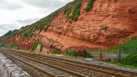 red rock and railway in Dawlish Warren, Devon Zdjęcie Seryjne