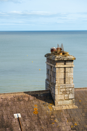 vintage chimney pots by the blue sea. Zdjęcie Seryjne