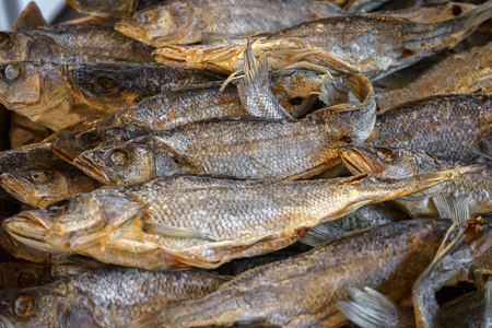 Dried salted fish vobla lies on the counter for sale