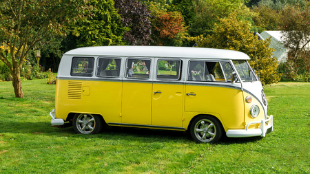 Classic vintage yellow Volkswagen Transporter camper van parked in the park, Devon, UK, August 26, 2017