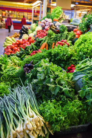 Fresh and organic vegetables at farmers market: raddish, tomatoes, dill, salad, green onoins garlic