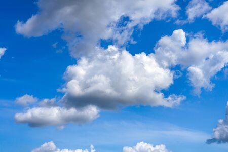 Blue sky with white clouds on sunny day.