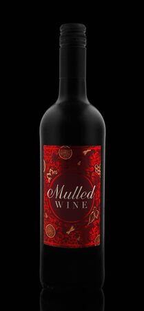 Mulled Red Wine Bottle, a Festive Fragrant Traditional Drink on the Black Background, Devon, United Kingdom, October 21, 2018. 스톡 콘텐츠 - 137615120