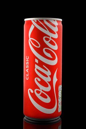 Coca-cola in aluminium can on black background, Devon, United Kingdom, October 21, 2018.