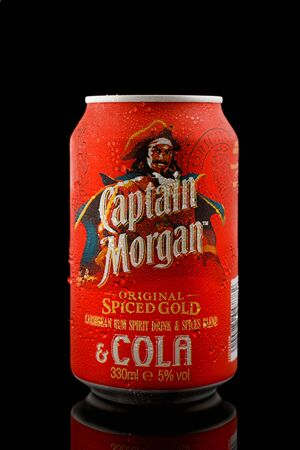 Captain Morgan rum, spices blend and cola cocktail in aluminium can with water drops on black background, Devon, United Kingdom, October 21, 2018. 스톡 콘텐츠 - 137615127