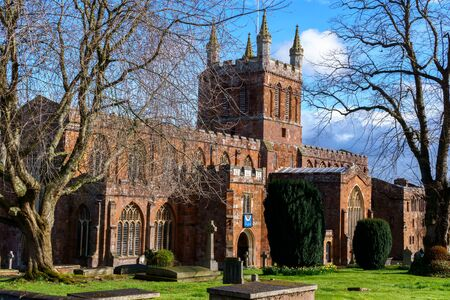 Crediton Parish Church of the Holy Cross and the Mother of Him Who Hung thereon in spring sunny day, Devon, UK, March 4, 2017.