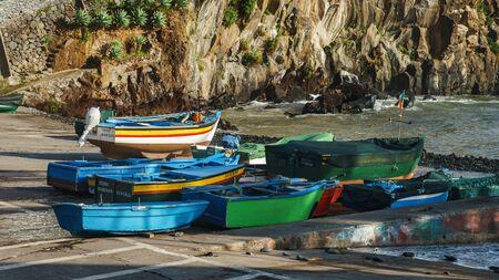 Colourful sailing fisher man boats in Camara de Lobos port, Madeira, Portugal, October 10, 2019 에디토리얼