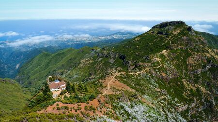 Beautiful panorama view of the footpath trail in the mountains of Pico Ruivo, Madeira. 스톡 콘텐츠