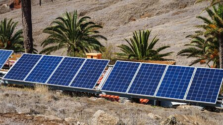 Photovoltaic modules, solar panels in sunny tropical valley.
