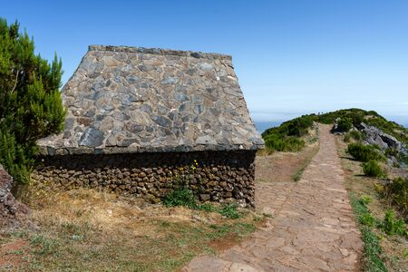 Beautiful panorama view of the stone footpath trail and house in the mountains of Pico Ruivo, Madeira.