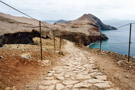 stone trail in mountain Trekking and hiking path.