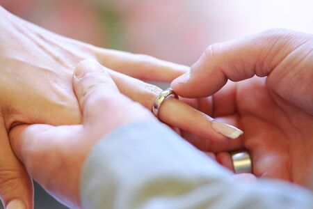 bride and groom Wedding ring exchange, straight marriage concept.