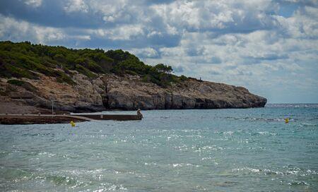 Santo Thomas beach in Menorca seascape, Spain. 스톡 콘텐츠