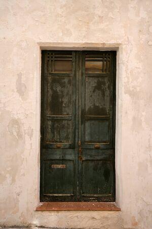 antique old wooden entrance door as background.