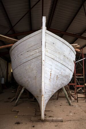 an old lobster fishing boat restoration in workshop. 스톡 콘텐츠 - 137500999