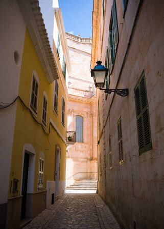 Street with colorful houses in old town of Ciutadella, Menorca, Balearic Islands, Spain, September, 2019 스톡 콘텐츠 - 139191390
