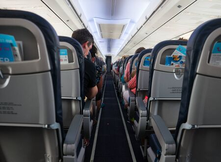 Interior of airplane with passengers on seats, Spain, September 16, 2019 스톡 콘텐츠 - 140246115
