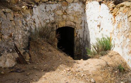 entrance of defensive artillery concrete fort, bunker built during the Second World War, Spain.