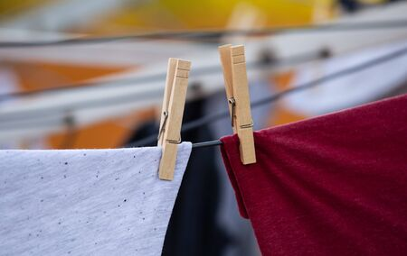 wooden pegs on drying clothes Washing day with laundry on clothesline.