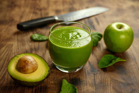 Green avocado, apple and spinach Smothie healthy food concept.