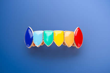 rainbow colored fake golden teeth Tooth Cap Jewelry party decoration.