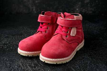 Autumn Pink leather girls boots warm shoes. Fashion Concept. 스톡 콘텐츠