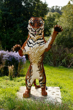 Tiger figure made out of many toy building bricks in zoo.
