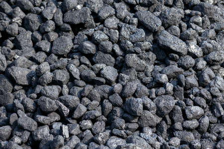 Black Coal pile as background in stock for steam train