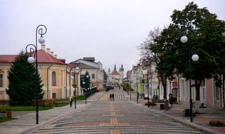 Lenin High street and Cathedral and of Assumption of Virgin Mary with Bell tower and monastery of the greyfriars, Pinsk Belarus October 16 2020.