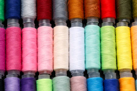 Sewing threads in row multicolored background closeup 스톡 콘텐츠