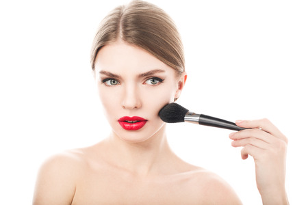 makeover: Beauty Girl with Makeup Brush. Beautiful Face. Makeover. Perfect Skin. Applying Makeup