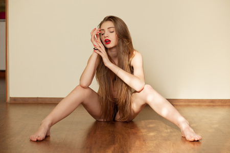 naked sexy girl: sexually excited, sexy girl in lingerie sits on parquet flooring Stock Photo