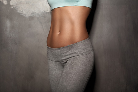 stomach: Fitness female woman with muscular body, do her workout, abs, abdominals Stock Photo
