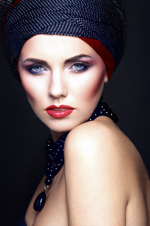 blue: fashion portrait of a beautiful woman with blue eyes