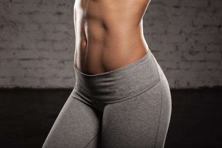 Fitness female woman with muscular body, do her workout, abs, abdominals Stock Photo