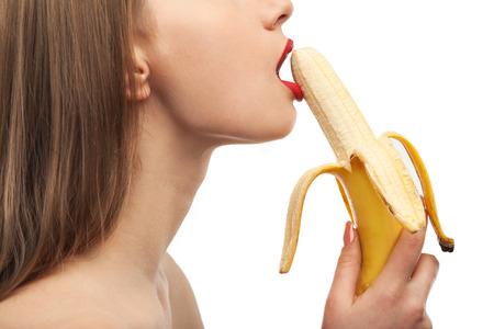 horny girl eats and licks the banana. oral sex