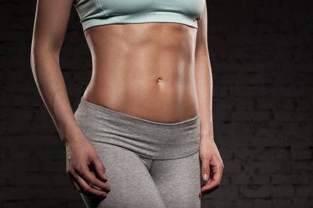 muscle woman: Fitness female woman with muscular body, do her workout, abs, abdominals Stock Photo