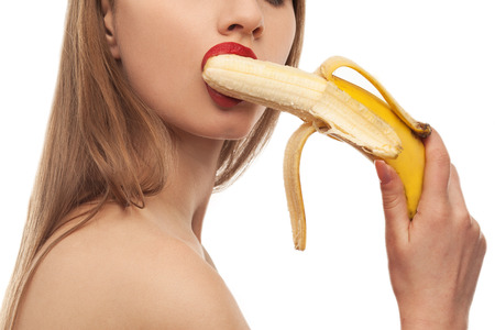 horny girl eats and licks the banana, oral sex Banque d'images