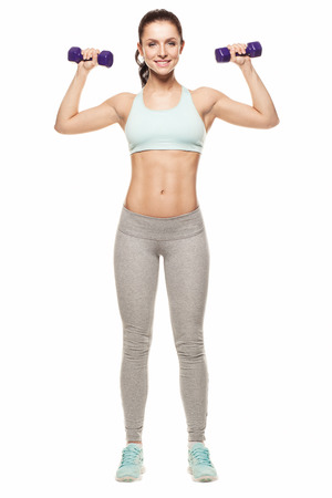 sporty woman do her workout with dumbbells, isolated on white background Stock fotó