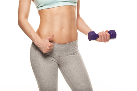 athletics: sporty woman do her workout with dumbbells, isolated on white background, thumbs up