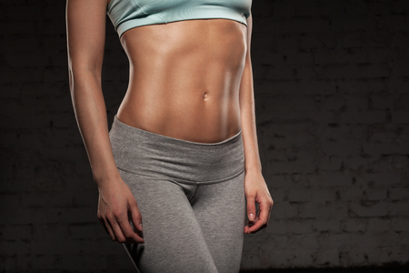 strong girl: Fitness female woman with muscular body, do her workout, abs, abdominals Stock Photo