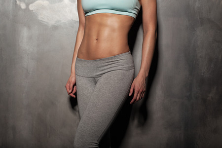 bra model: Fitness female woman with muscular body, do her workout, abs, abdominals Stock Photo