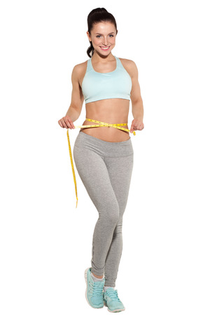 weight loss, sports girl measuring her waist, training in the gym, workout abdominals Stockfoto
