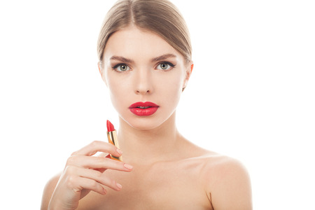 closeup portrait of a beautiful woman with beauty face and clean skin with lipstick in hand
